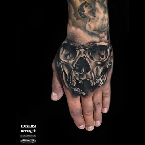 hand tattoo skull black and grey