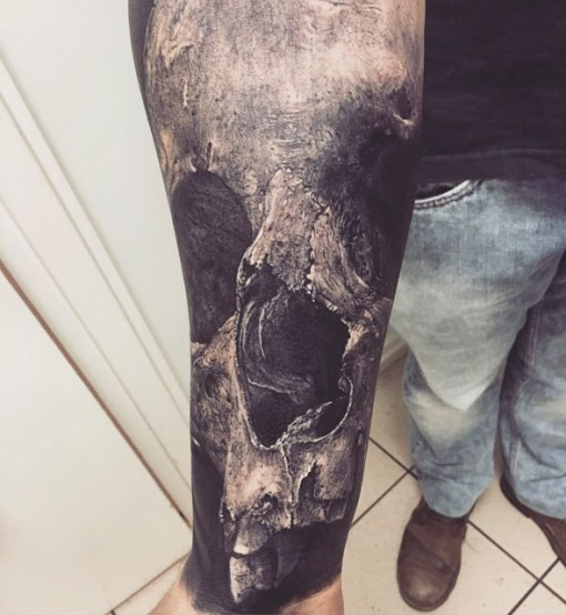 remarkably realistic skull tattoo on full forearm