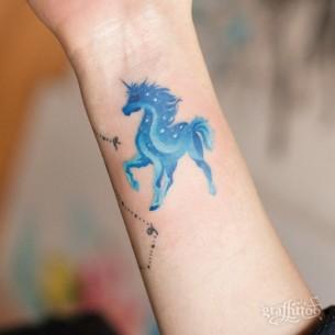 Small Unicorn Tattoo