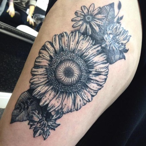 sunflower tattoo on shoulder with blue inks