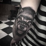 elbow tattoo wolf