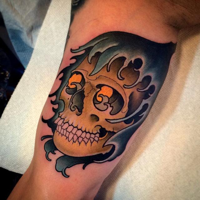 wave hood skull tattoo on arm