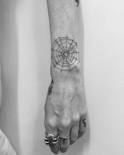 spider web tattoo on wrist