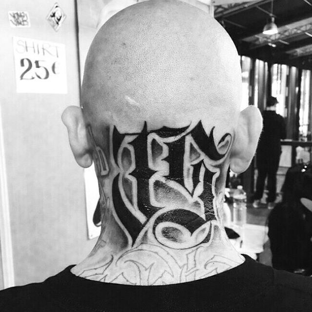 back neck Chicano tattoo