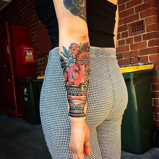 forearm traditional flowers tattoo