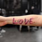 pink love tattoo word