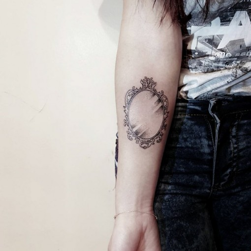 mirror tattoo on arm