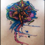 Watercolor wind rose tattoo on back