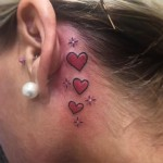 3 red Hearts Tattoo behind ear