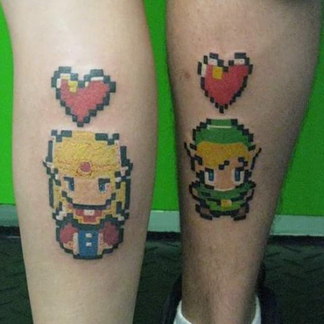 A Zelda and Link couple tattoo! Done by Kenny Tetrault