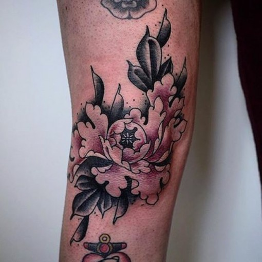 Above Knee Tattoo