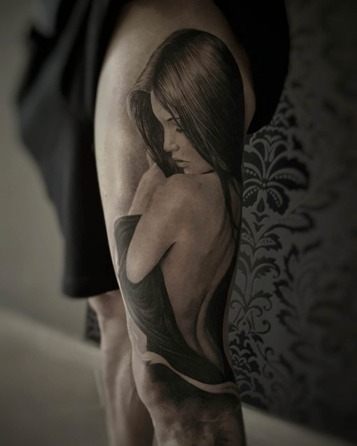 beautiful black and grey tattoo girl on thigh