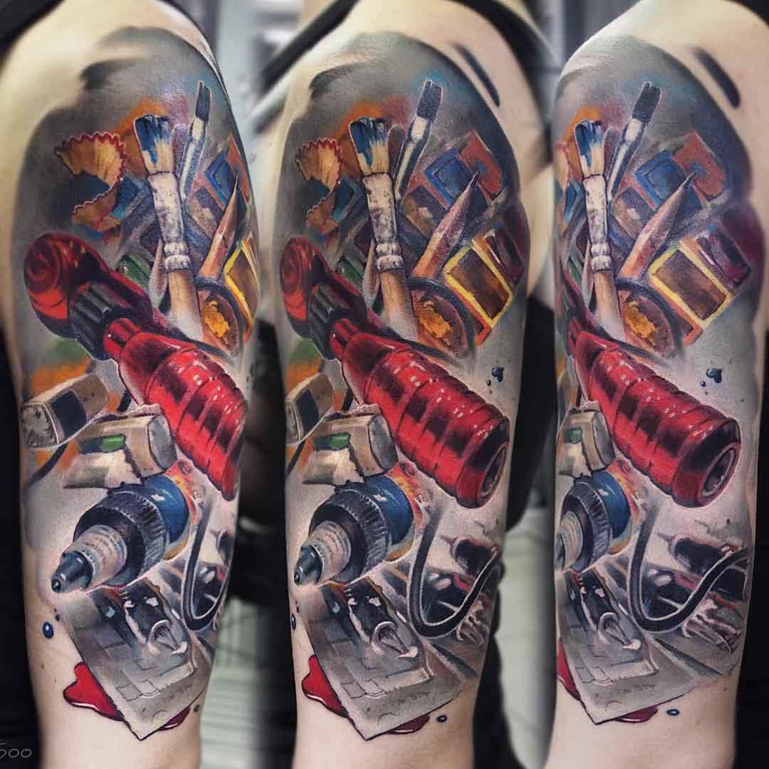 artist tools tattoo on shoulder