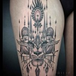 bastet tattoo on thigh