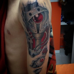 Biomechanical Skin Rip Tattoo