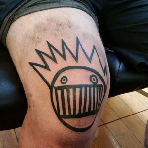 Black Lines Face Tattoo on Knee