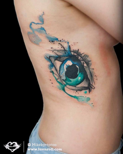 watercolor rib tattoo eye