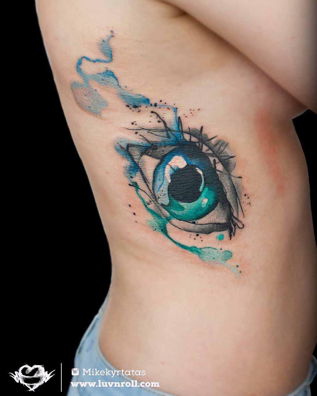 watercolor rib tattoo eye