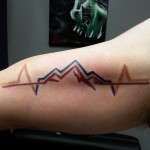 Cardio Mountains Tattoo on BIcep
