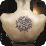 back mandala tattoo with cat head