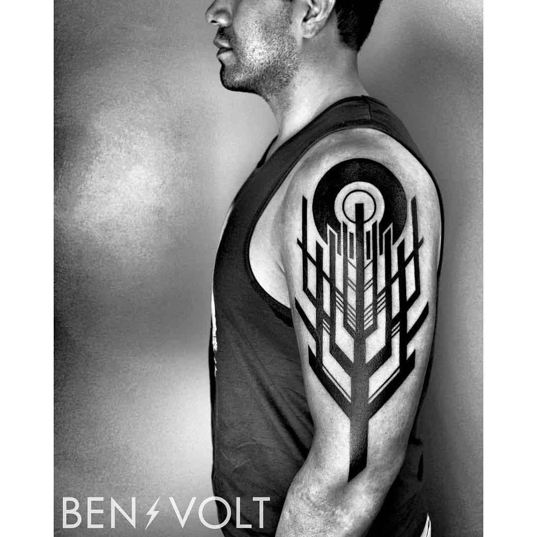 black shoulder geometric treee tattoo