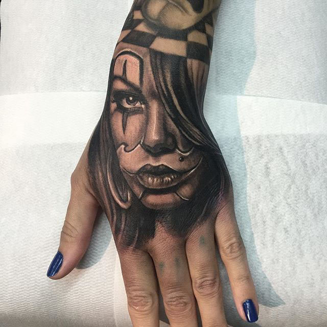 hand tattoo Chicano girl