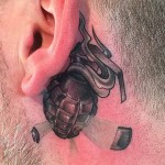 Grenade Tattoo Behind Ear