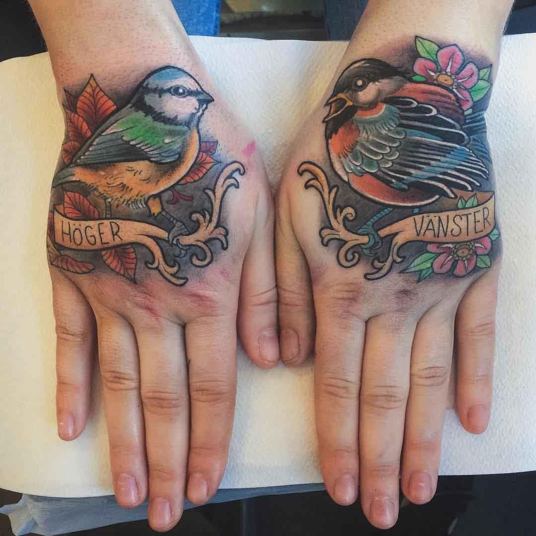 birds tattoos on hands