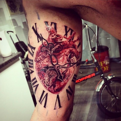 Heart Clock Tattoo on Bicep by the_mad_tatter_