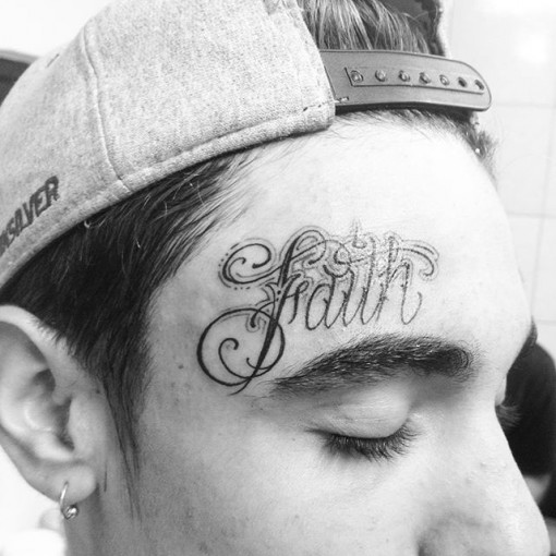 Lettering Chicano Tattoo on Forehead