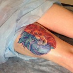 lion head red and blue tattoo