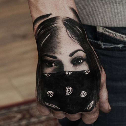 chicano Mexican girl tattoo on hand