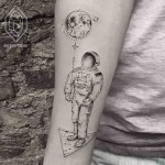 astronaut with moon tattoo