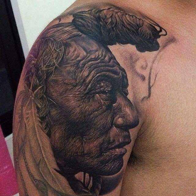Realistic Indian Tattoo on Shoulder by Koko Goldfinger Tattoo Studio