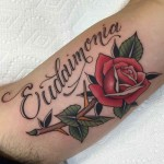 neo-traditional rose lettering tattoo