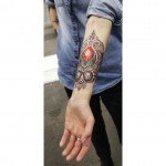arm tattoo red ruby