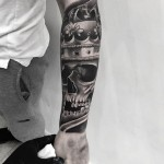 half sleeve tattoo skull king