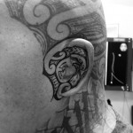 Tribal Ear Tattoo by bronzink
