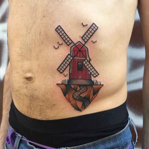 stomach windmill tattoo