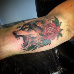 Wolf and Rose Tattoo on Bicep