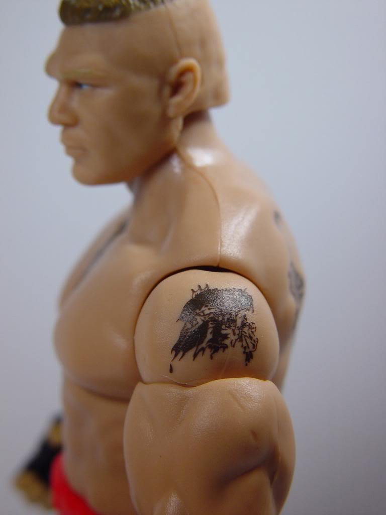predator tattoo on left shoulder brock lesnar