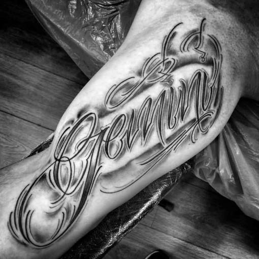 gemini inner bicep tattoo lettering