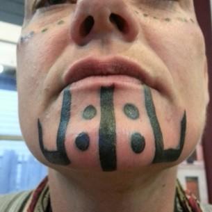 Black Tribal Chin Tattoo