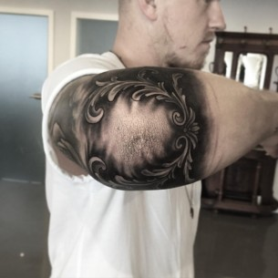 Black and Grey Elbow Tattoo