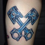 Crossed Pistons Tattoo by @studio77tattoo