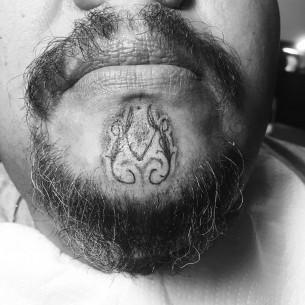 Curvy Pattern Chin Tattoo