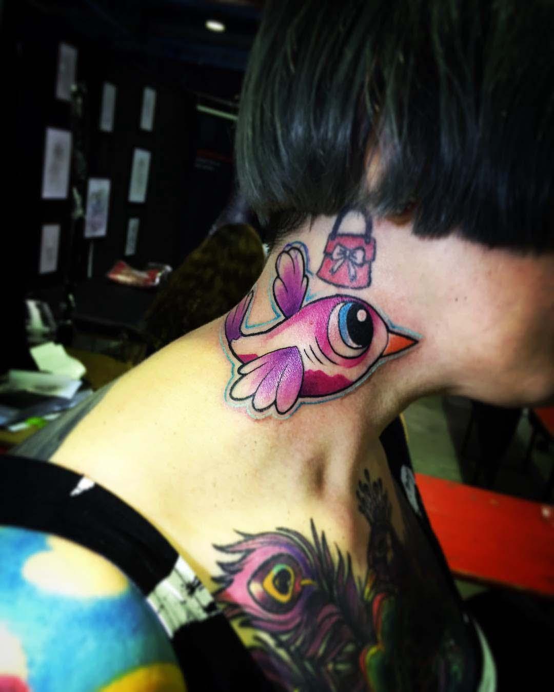 neck tattoo cute bird