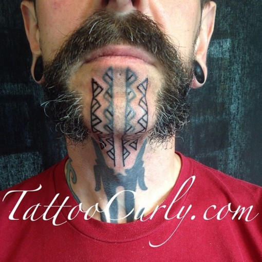 Ethnic Chin Tattoo by curlytattoo