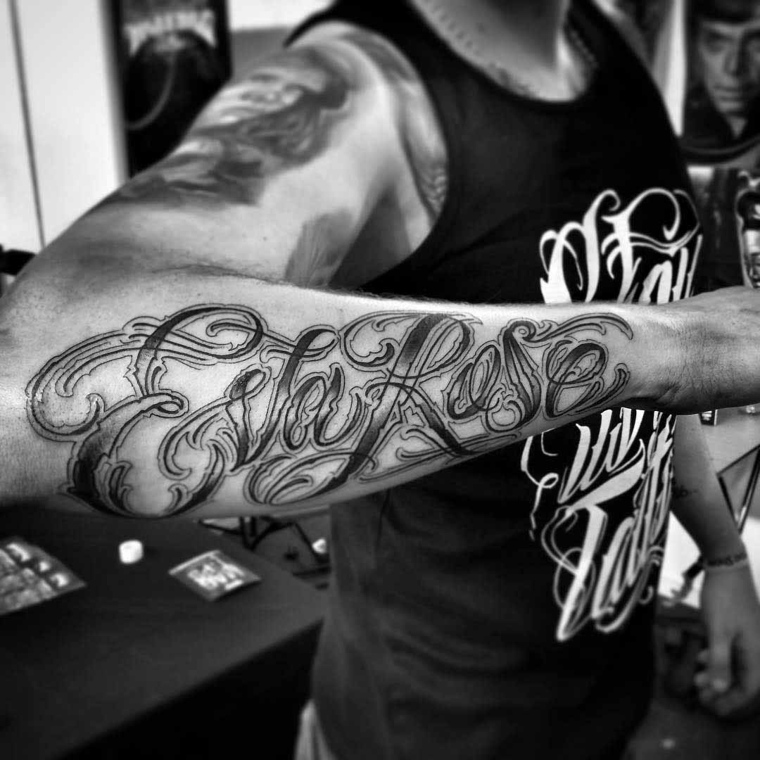 name tattoo on forearm