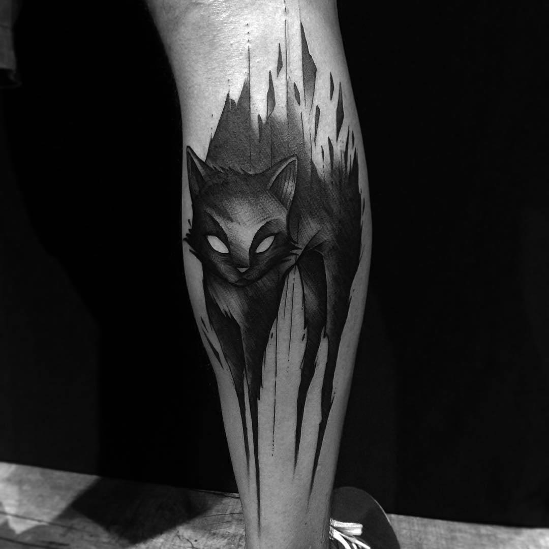demonic cat tattoo on leg